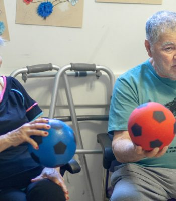 person with dementia doing movement therapy